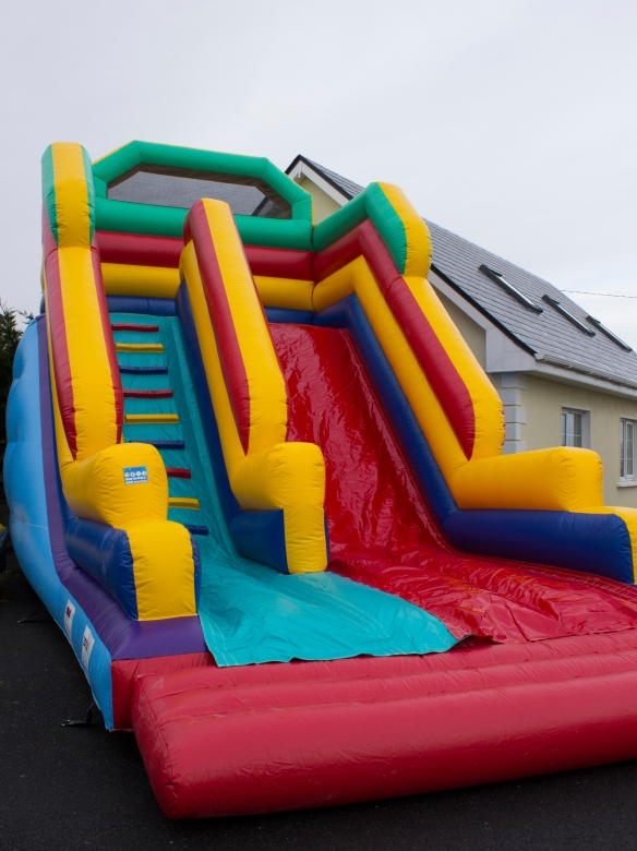 Superslide Size: 25ft x 19ft This is a 19ft Super slide, fitted with safety netting and high walls at the top of the slide and a long landing area. This is a huge hit with children of all ages. Price: €130.00 Above price includes 10 free party bags and a catering table with chairs. To hire, call 0872374610