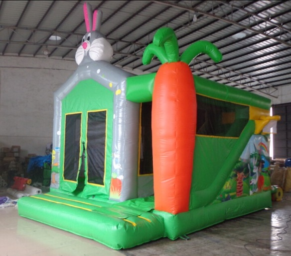 Bugs Bunny Combi Unit Size: 18ft x 15ft This eye catching themed combi unit includes a bouncing area and a slide to the side, both fully enclosed. Price: €110.00-120 Above price includes 10 free party bags and a catering table with chairs. To hire, call 0872374610