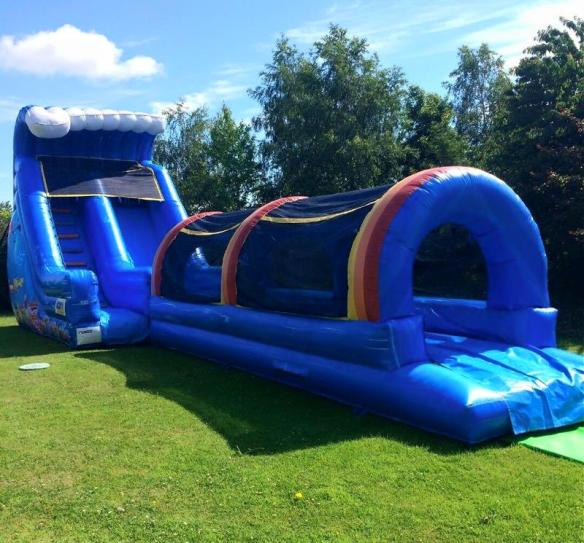 Waterslide Size: 50ft x 12ft x 19ft Brand New for 2017! This is a huge 19ft Water Slide whereby the hose goes to the top of the slide to allow the water to run down. When you slide you continue for 10 metres. It has safety netting on the top. Price: From €160 Above price includes 10 free party bags. To hire, call 0872374610